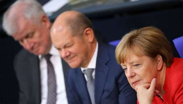 German Chancellor Angela Merkel, Finance Minister Olaf Scholz and German Interior Minister Horst See