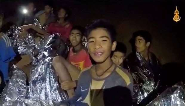 Boys from the under-16 soccer team trapped inside Tham Luang cave covered in hypothermia blankets re