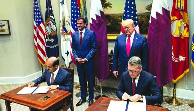 HE Saad Sherida al-Kaabi and Lashier sign the agreement to to develop a new world-scale petrochemica