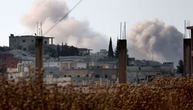 Smoke billows in the village of Hamameya in Syria's Idlib province