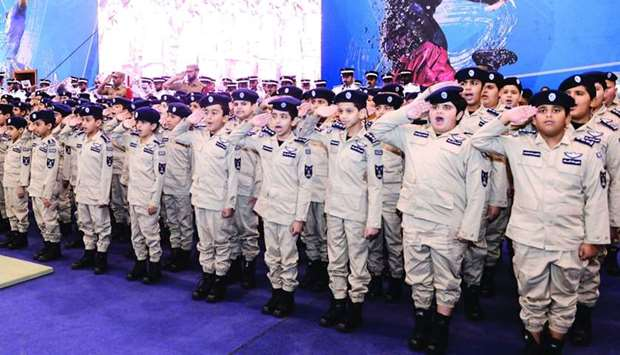 Students salute officials during graduation of the Summer Camp at Police College