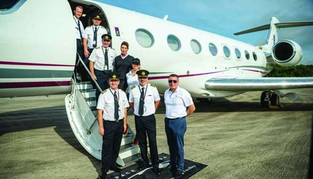 Qatar Executive crew with the 'One More Orbit' team pose in front of the Gulfstream G650ER.