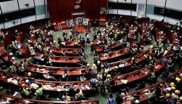 People are seen inside a chamber, after protesters broke into the Legislative Council building durin