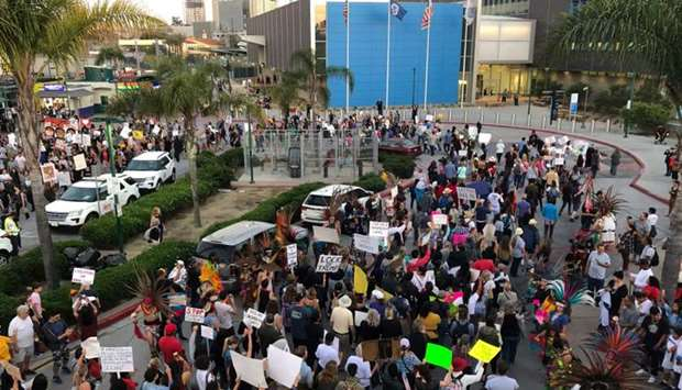 Demonstrators gathers outside the San Ysidro Port of Entry to protest the treatment of immigrants in