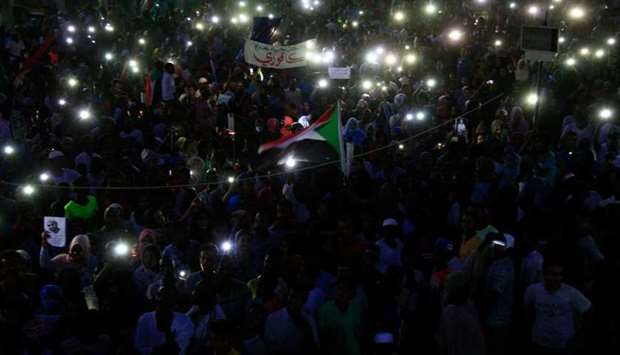 Sudanese protesters take part in a vigil in the capital Khartoum's northern district of Bahri, to mo
