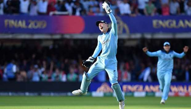 England's Jos Buttler celebrates after they win the super over to win the 2019 Cricket World Cup fin