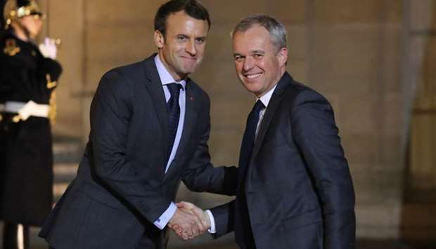 In this file photo taken on November 20, 2017 French president Emmanuel Macron (L) welcomes then Nat