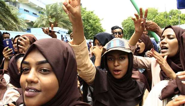 Scores of students of a Khartoum-based university celebrate after an agreement was reached between p