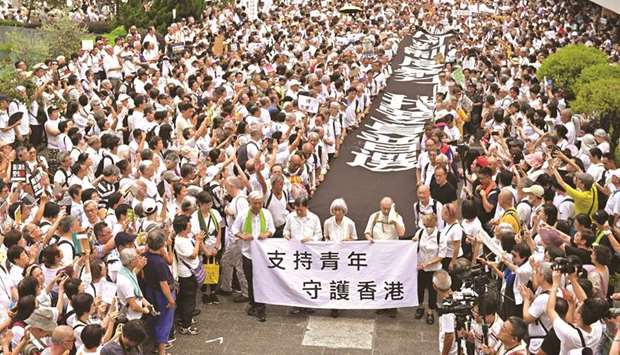 Hong Kong's 'grey hairs' march to support protesters