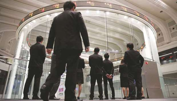 Asian markets hit by trade worries, Fed rate cut uncertainty