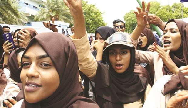 Students of a Khartoum-based university celebrate an agreement between protest leaders and members o