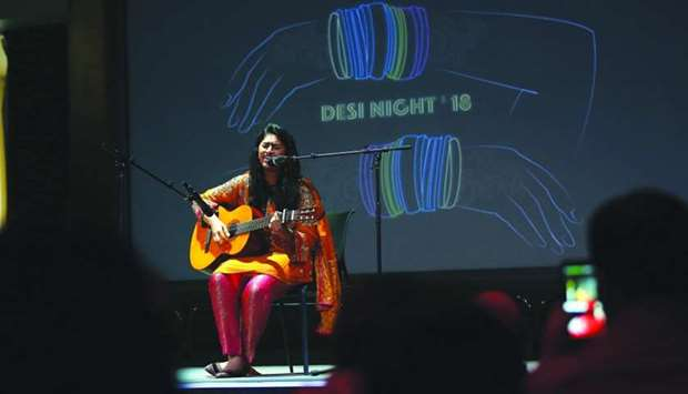 An Indian student performing at the student-organised 'Desi Night' at QF partner university Virginia