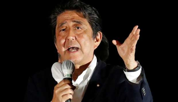 Japan's Prime Minister and Liberal Democratic Party's (LDP) leader Shinzo Abe speaks to voters