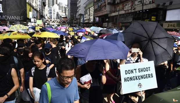 Protesters march against a controversial extradition bill in Hong Kong