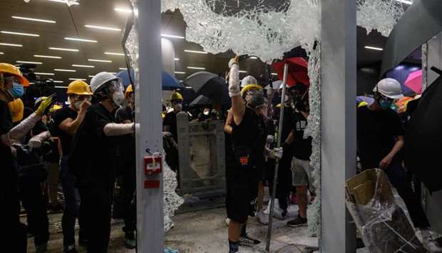 Protesters smashing glass doors and windows of the government headquarters in Hong Kong on the 22nd