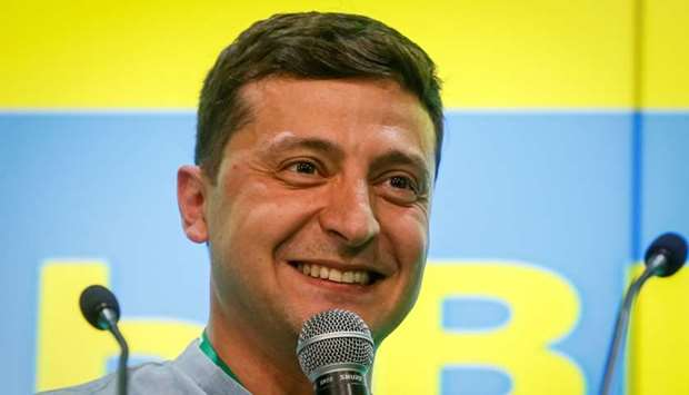 Ukraine's President Volodymyr Zelenskiy speaks at his party's headquarters after a parliamentary ele