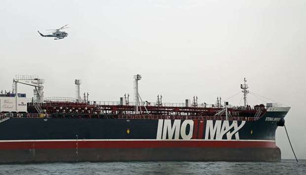 Iranian Revolutionary Guards patrolling around the British-flagged tanker Stena Impero July 21 as it