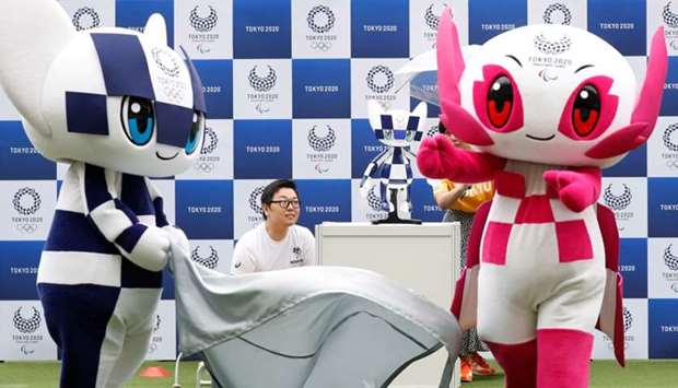 Tokyo 2020 mascot robot Miraitowa is unveiled by mascots Miraitowa and Someity