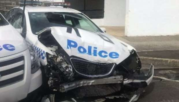 The police patrol car after being hit by the drug-filled van - in Sydney