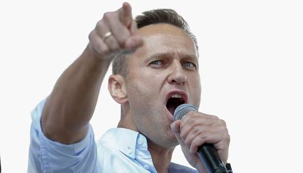 Russian opposition leader Alexei Navalny addresses demonstrators during a rally