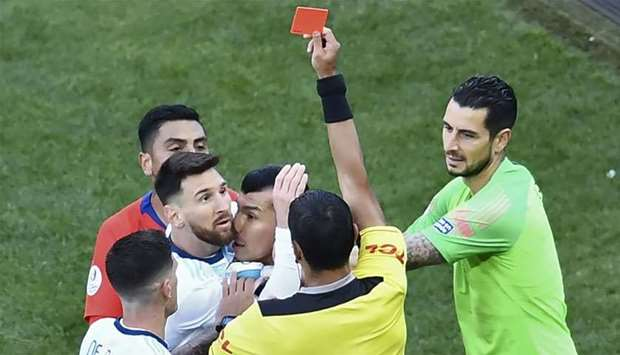 Paraguayan referee Mario Diaz de Vivar shows the red card to Argentina's Lionel Messi and Chile's Ga