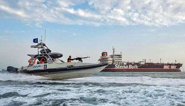 Iranian Revolutionary Guards in speedboats patrolling a tanker Stena Impero as it's anchored off the