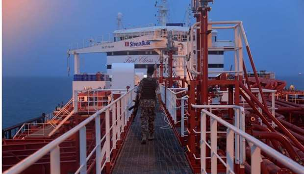 An Iranian Revolutionary Guard member walks onboard of Stena Impero, a British-flagged vessel owned