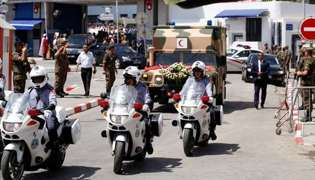 A general view shows an ambulance that carries the body of late Tunisian President Beji Caid Essebsi
