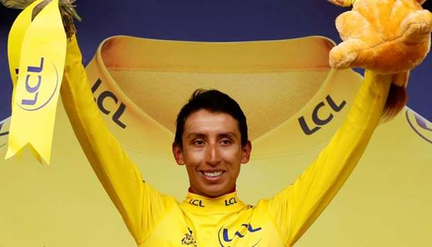 Team INEOS rider Egan Bernal of Colombia celebrates on the podium, wearing the overall leader's yell