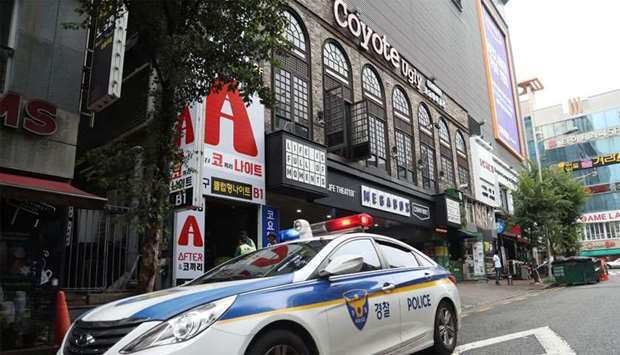 Police secure the area outside a night club after its upper floor collapsed in Gwangju