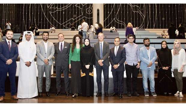 GROUP: Global Shapers Doha Hub and AYCM Qatar members with the guest of honour Ajay Sharma, Ambassad