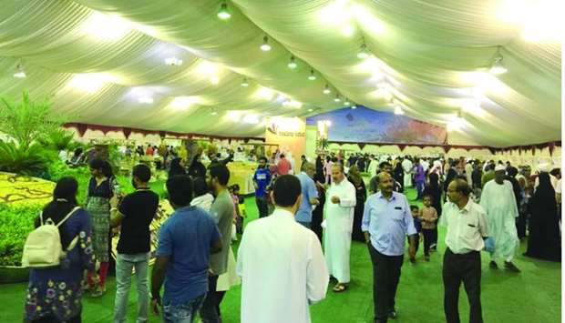 People visiting the ongoing Local Dates Festival at Souq Waqif