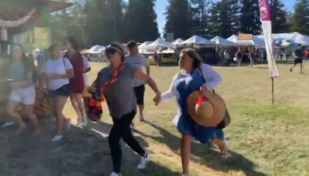 People run as an active shooter was reported at the Gilroy Garlic Festival, south of San Jose, Calif