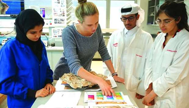 The student interns at ExxonMobil Qatar work closely with scientists and researchers.