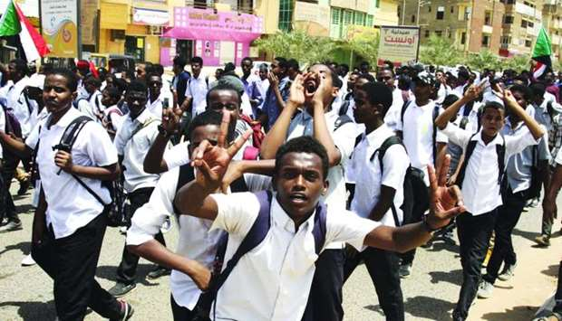 Sudanese students protest in the capital Khartoum, a day after teenagers were shot at a rally agains