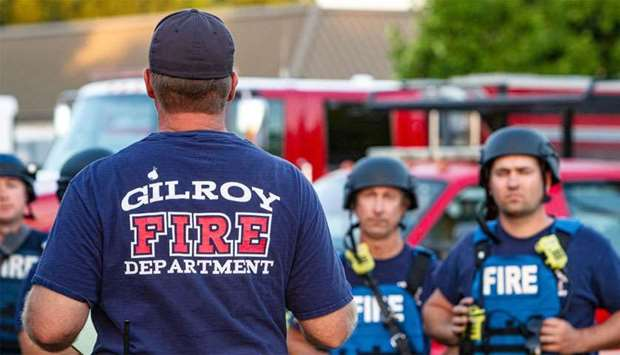 Emergency personnel work at the scene of a mass shooting during the Gilroy Garlic Festival