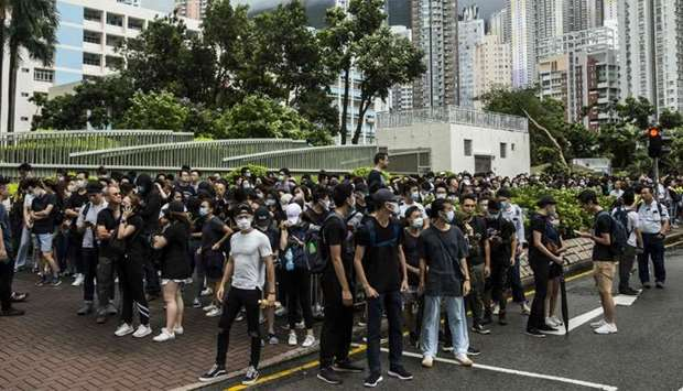 Demonstrators gather outside the Eastern district court in Hong Kong in support of protesters who ha