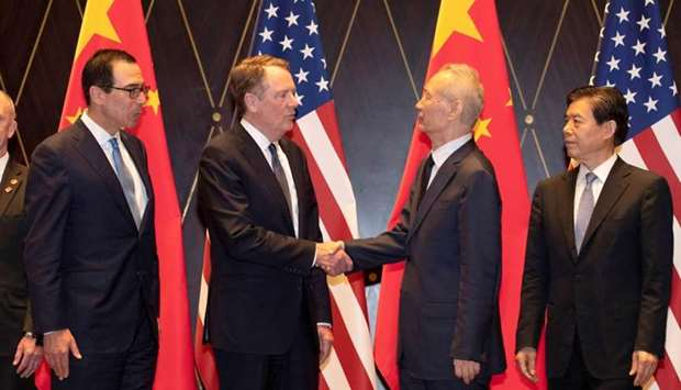 Trade Representative Robert Lighthizer shakes hands with Chinese Vice Premier Liu He as US.Treasury