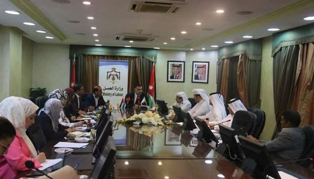 Jordan's Minister of Labour Nedal el-Batayneh in a meeting with a Qatari delegation