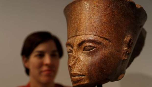 Laetitia Delaloye, head of antiquities of Christie's, poses for a photograph with an Egyptian brown