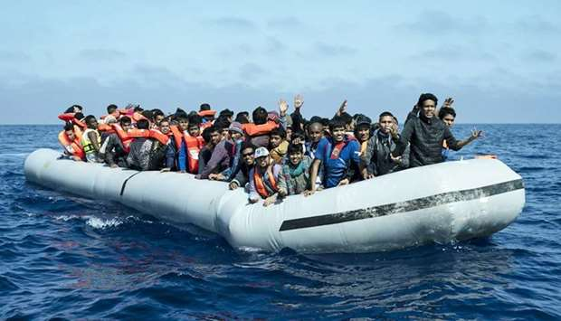 A group of migrants on an inflatable boat.