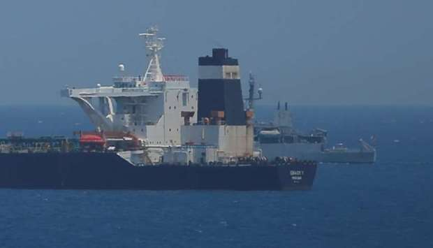 British Royal Navy patrol vessel guards the oil supertanker Grace 1, that's on suspicion of carrying