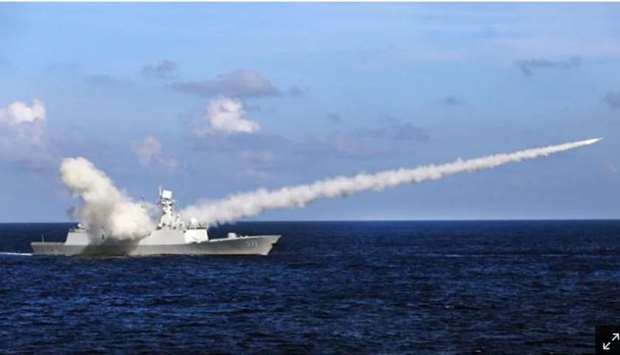 The Chinese missile frigate Yuncheng launches an anti-ship missile during a military exercise in the