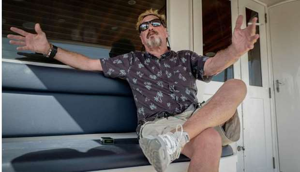 US millionaire John McAfee gestures during an interview with AFP on his yacht anchored at the Marina