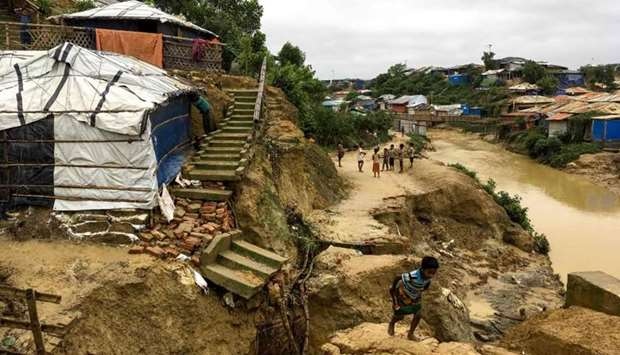 Rohingya children walk around a landslide area at Balukhali refugee camp in Ukhia