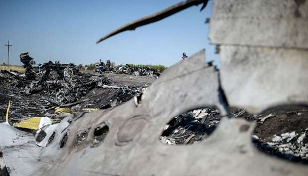 In this file photo taken on August 02, 2014 A part of the Malaysia Airlines Flight MH17 at the crash