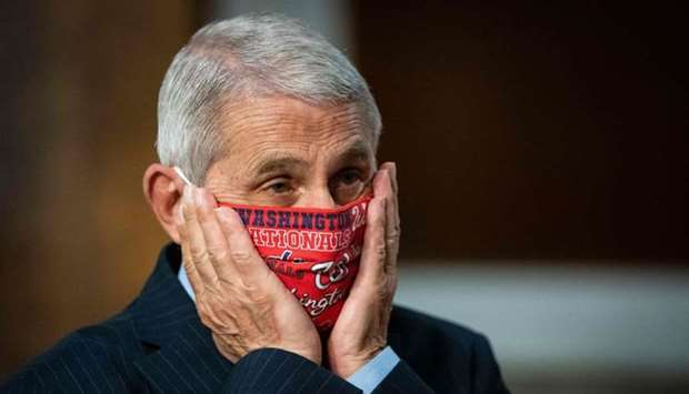 Dr. Anthony Fauci, director of the National Institute for Allergy and Infectious Diseases, prepares