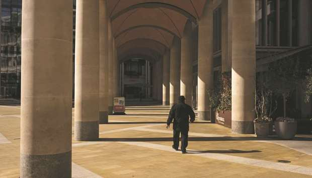 A man walks past the London Stock Exchange building. The FTSE 100 closed up 0.8% to 6,095.41 points