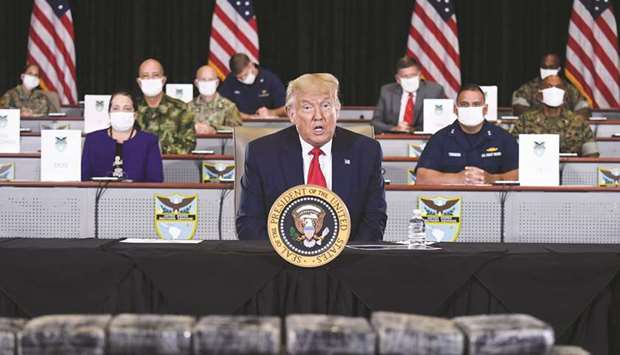 President Donald Trump speaks as he is briefed on enhanced narcotics operations at the US Southern C