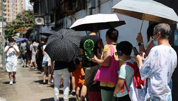 People queue to vote for New Territory East candidates during a primary election in Hong Kong